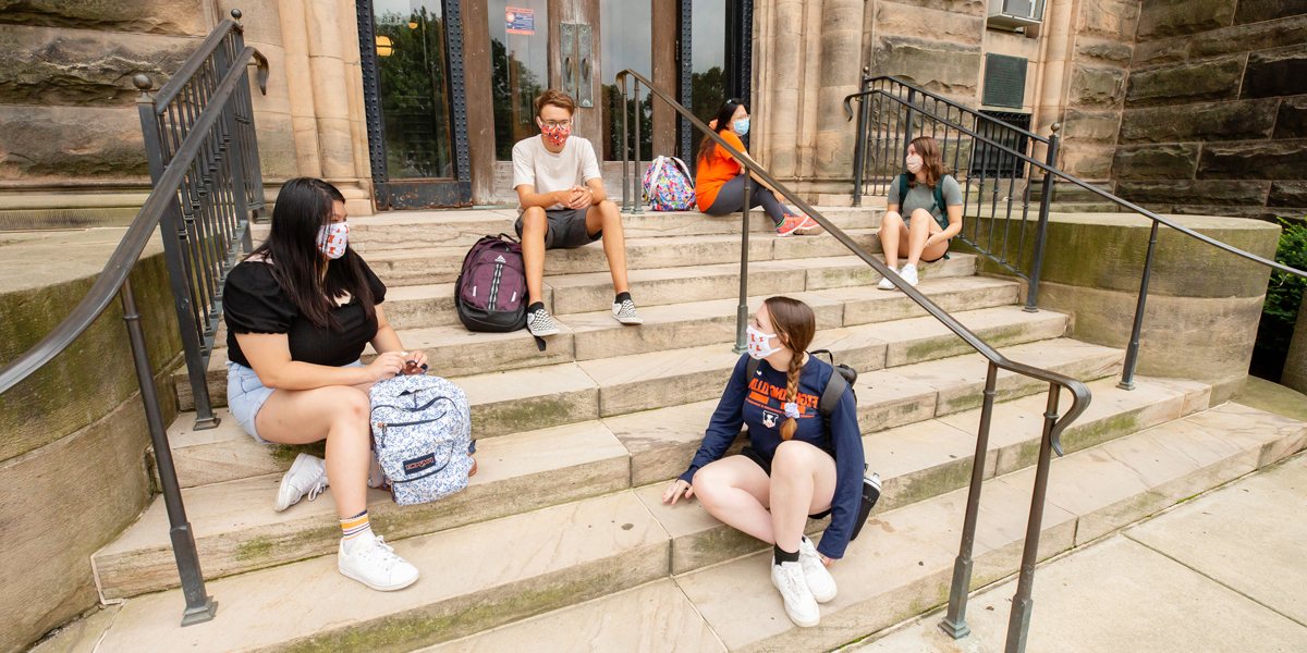 Students sitting on the steps of Altgeld